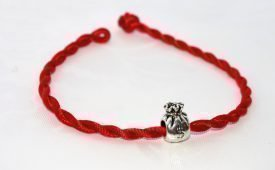Значение браслета желаний красная нить
